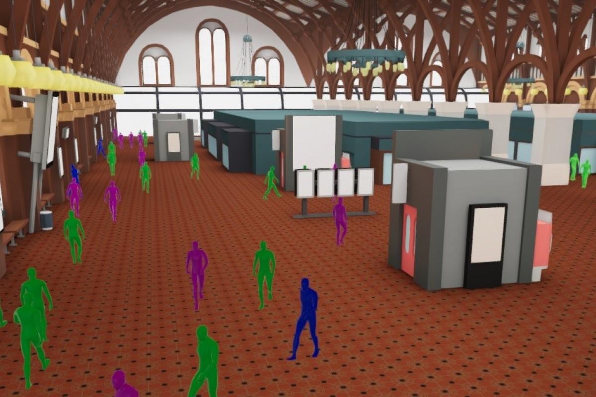 Screenshot af 3D-modellens forskellige agent-typer, der bevæger sig igennem banegårdshallen